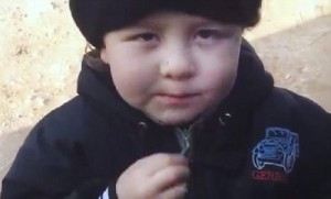 4 year old firing an AK 47 in Syria