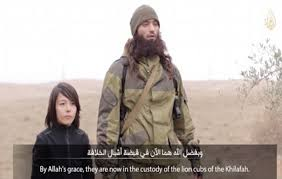 Child identified as Abdullah is executing 2 allegedly Russian spies.
