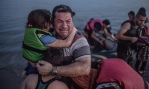 Syrian father arriving in Greece.