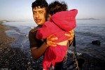 Syrian refugee arriving to Kos with baby in a dinghy